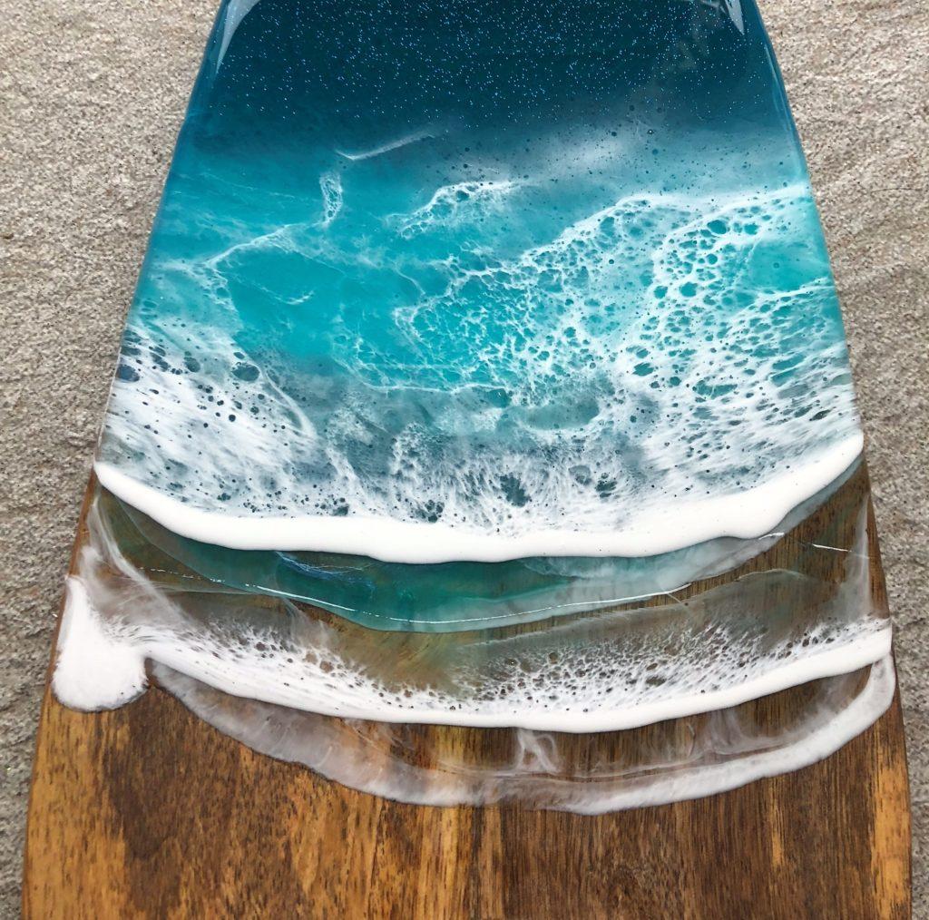 Sjø-kunst laget på treplanke